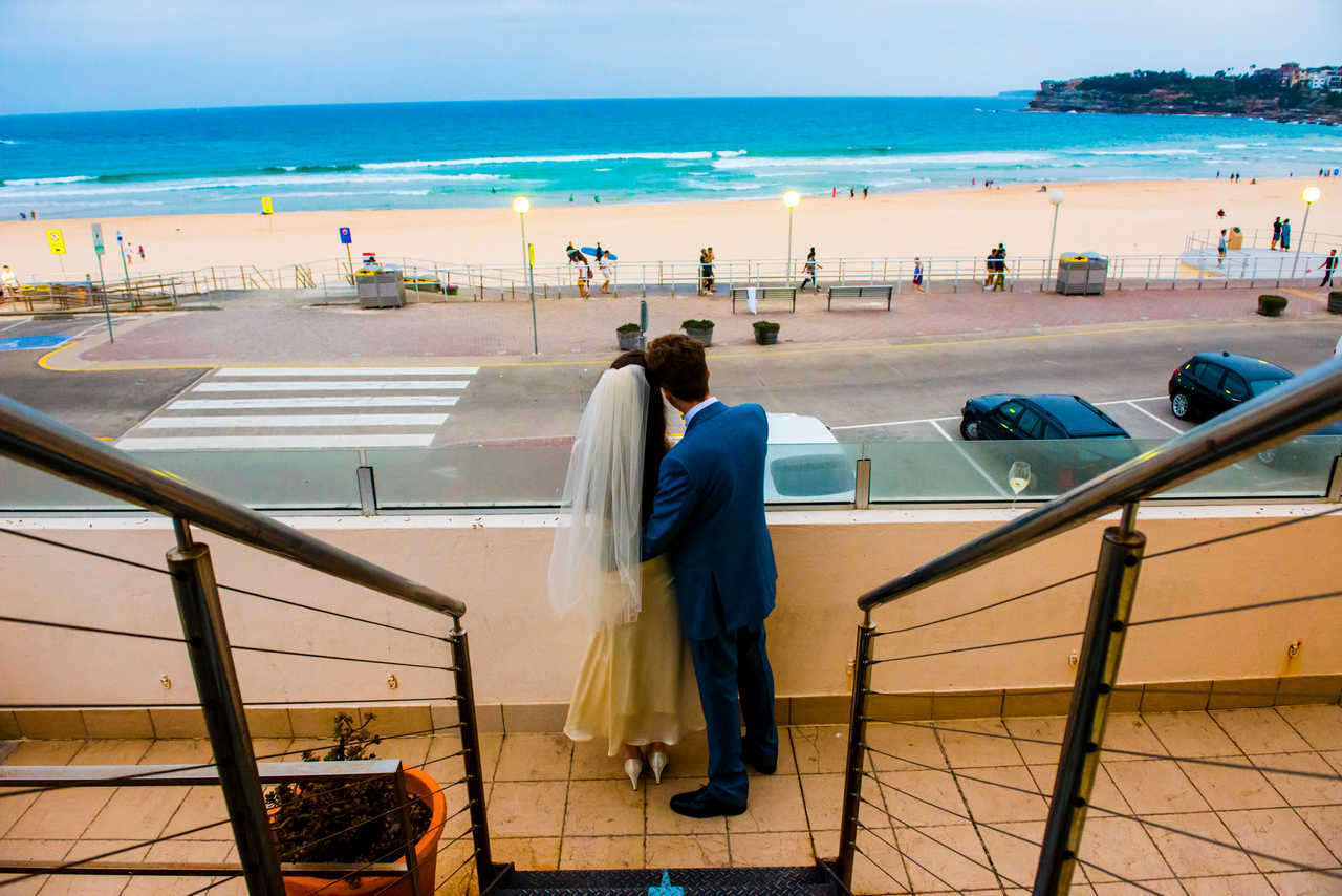 couple overlooking bondi beach