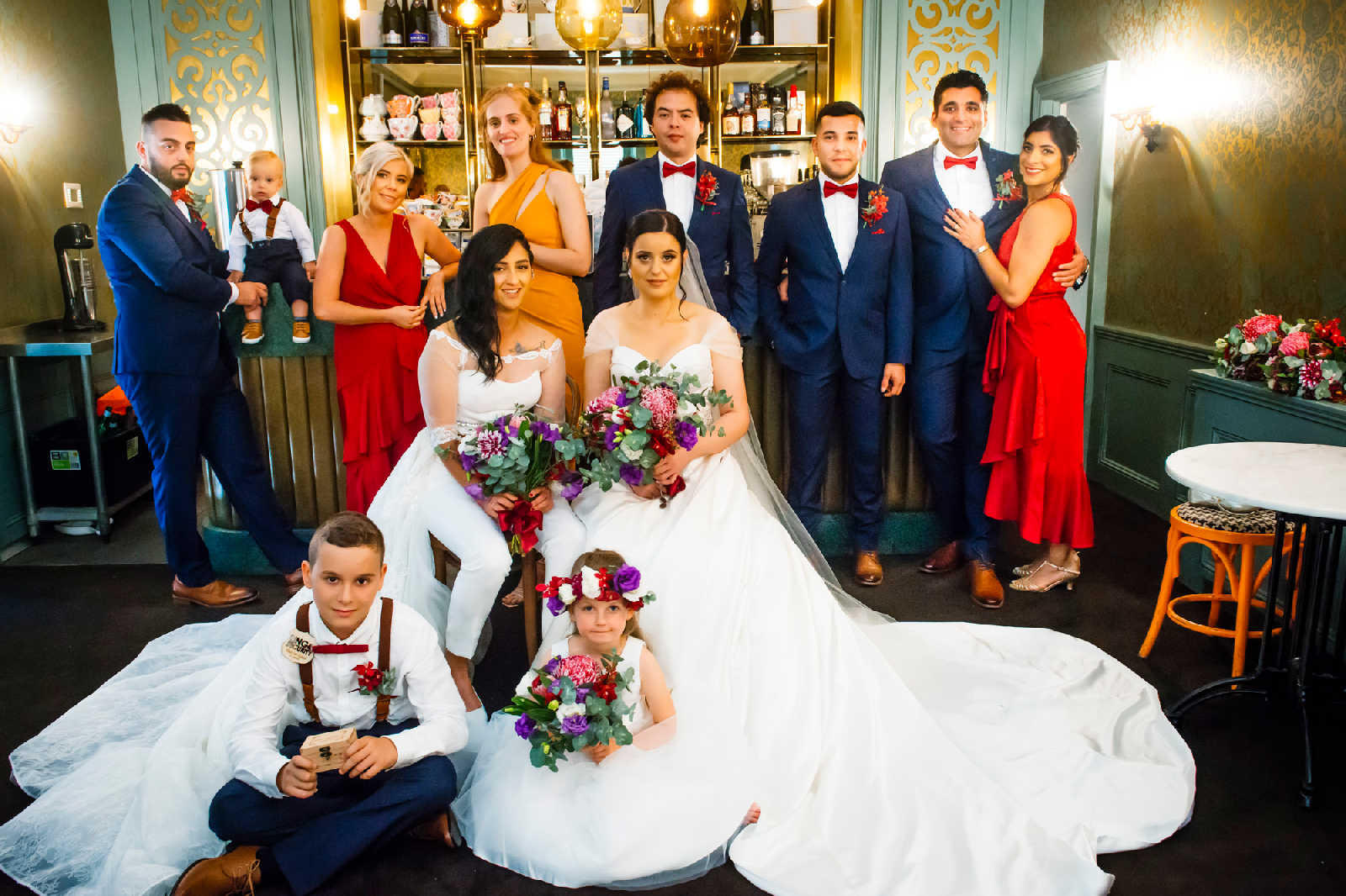 2 brides and their bridal party
