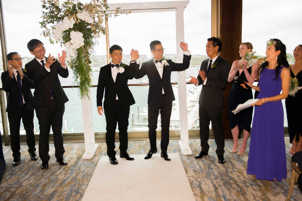 2 grooms just married and announced as husband and husband