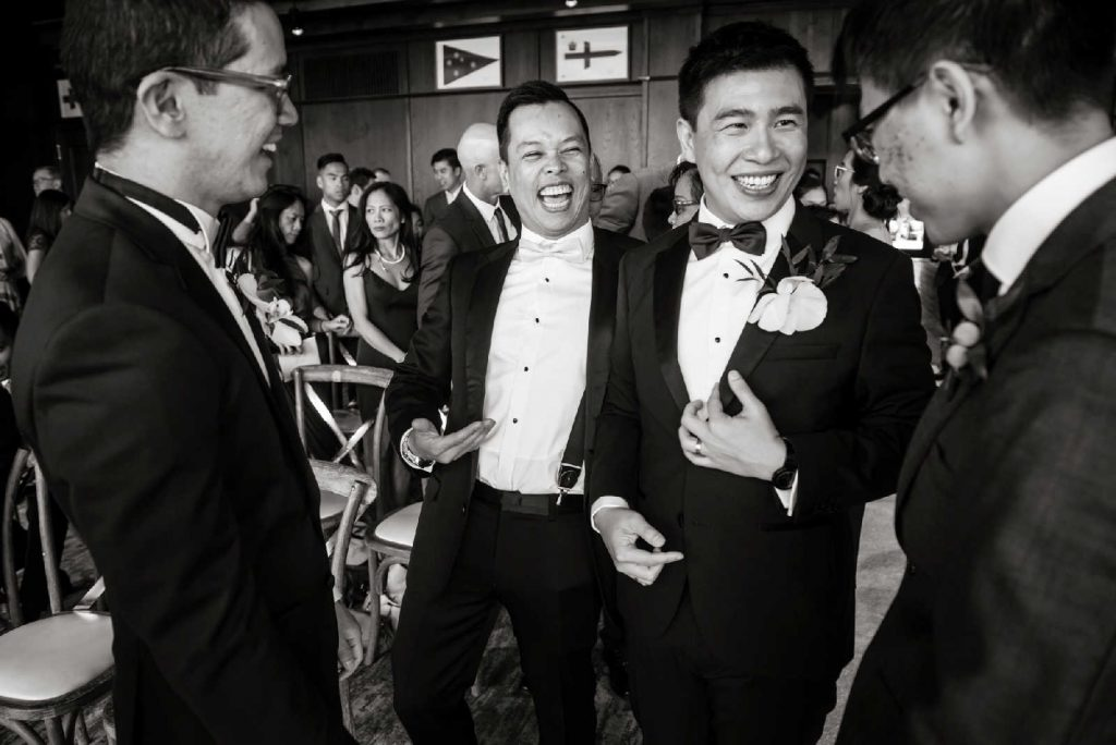 gay groom chatting with guests