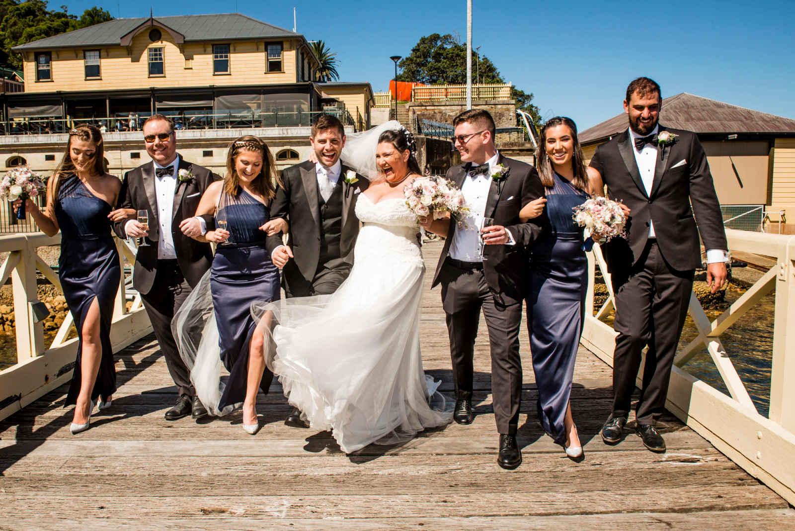 bridal party walking along the jetty near sergeants mess