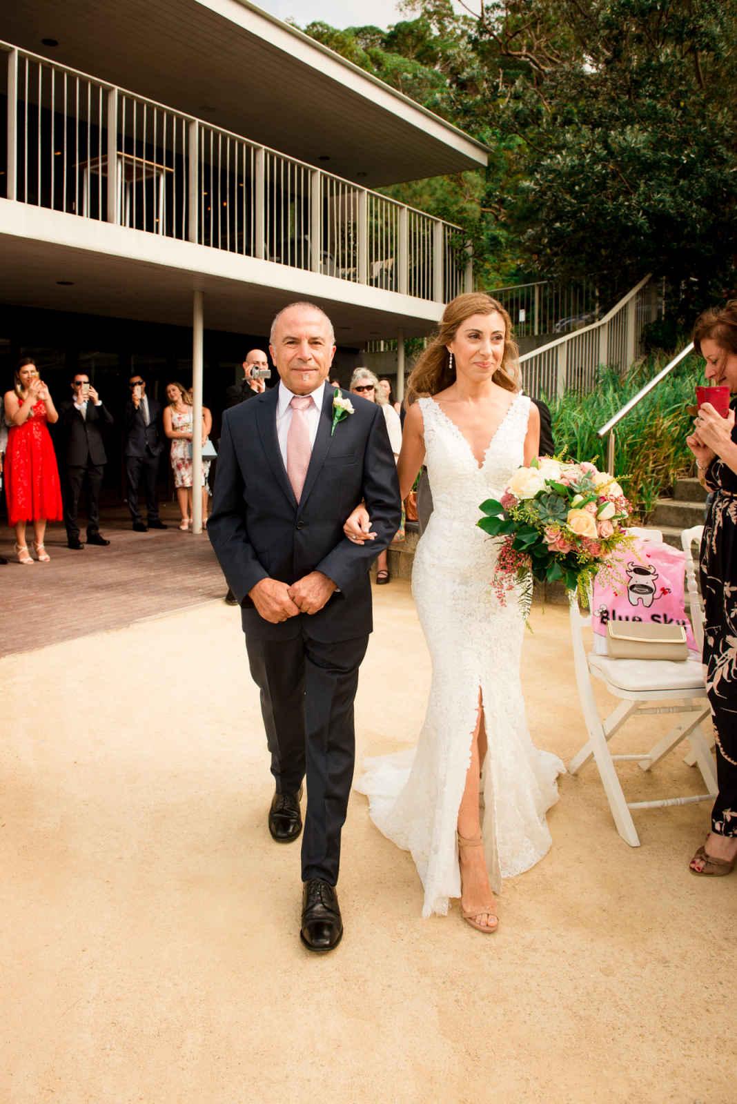 father of the brode walking bride down the aisle at sergeants mess
